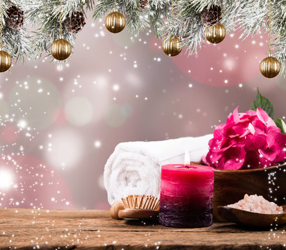 Christmas Spa concept. Gift. Massage, towel and other thing. Holiday blur background and balls.