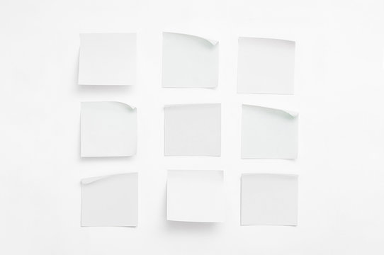 Set of white sheets of paper for notes with curled corners. Empty colorless stickers square shape