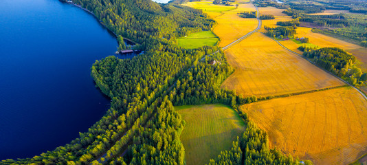 Aerial view of Pulkkilanharju Ridge, Paijanne National Park, southern part of Lake Paijanne. Landscape with drone. Blue lakes, fields and green forests from above on a sunny summer day in Finland. Wall mural