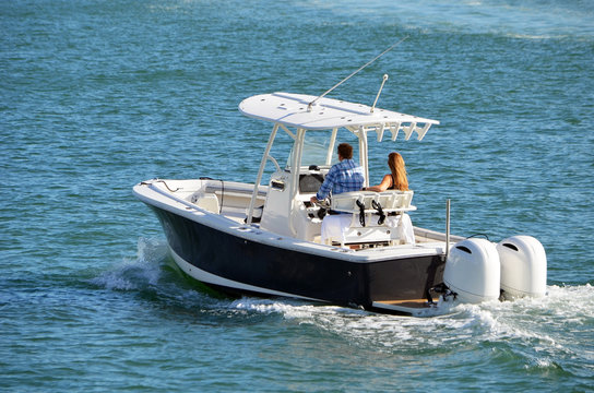 Man and a woman enjoying a slow cruise on the Florida Intra-Coastal Waterway off  Miami Beach in a sport fishing boat