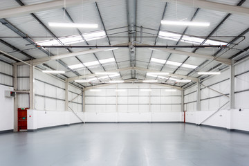 An interior of a large, empty warehouse