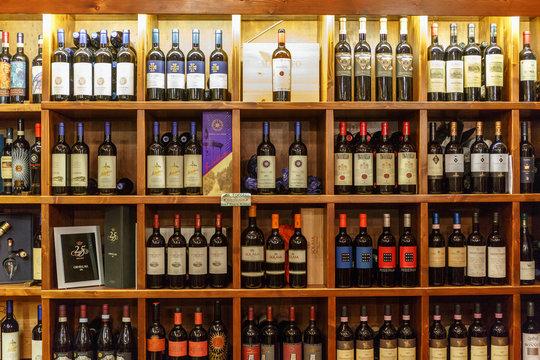 Wine bottles in shelves in a wine shop