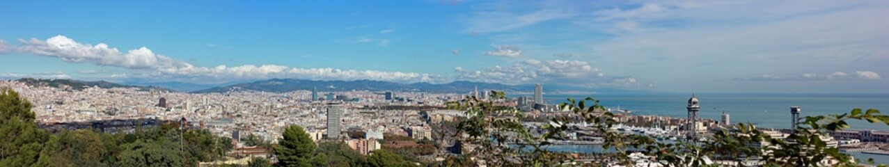 Panoramic view above city Barcelona from Saglada Familia to harbor