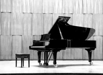 Grand piano set on stage, B&W