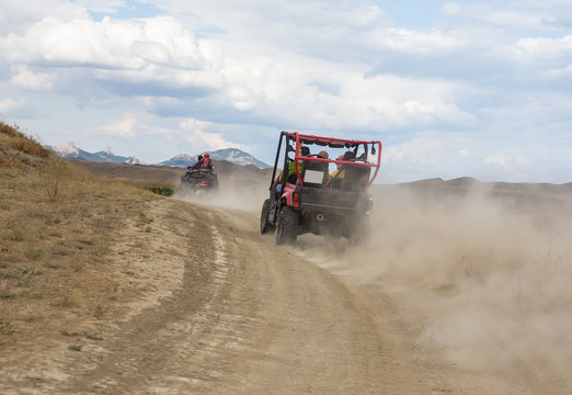 Buggy moves on a dirt dusty road