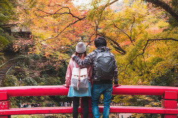 Young couple traveler looking beautiful landscape at minoo park in Japan, Travel lifestyle concept