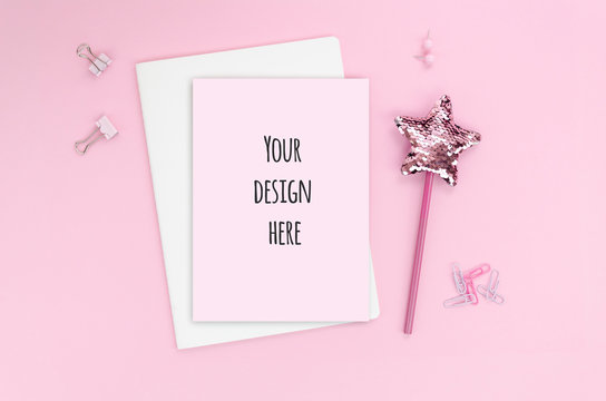 top view glamour female minimal concept with a paper list on a pink background. flat lay with pink stationery and magic wand and copy space