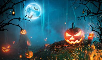 Spooky halloween pumpkins in dark forest