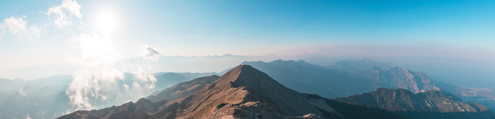 Panoramic view of Taurus Mountain at sunset from the top of Tahtali Mountain near Kemer, Antalya,...