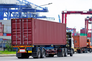 Container truck in ship port Logistics.Transportation industry in port business concept.import,export logistic industrial Transporting Land transport on Port transportation storge         - fototapety na wymiar