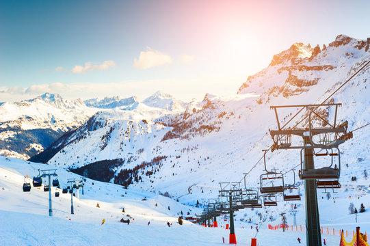Ski resort in winter Dolomite Alps. Val Di Fassa, Italy. Beautiful mountains and the blue sky, winter landscape