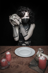 Gothic girl in leather mask