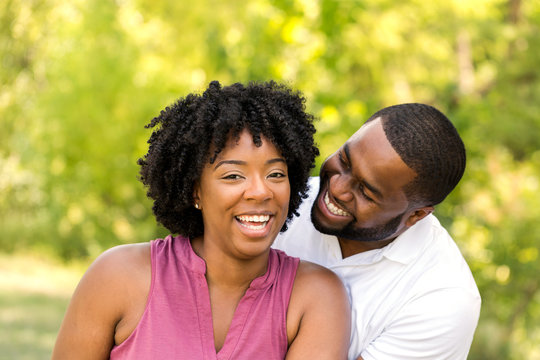 Happy African American couple laughing and smiling.