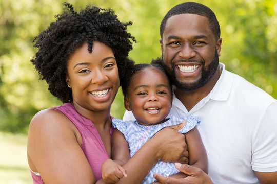 Happy African American family laughing and smiling.
