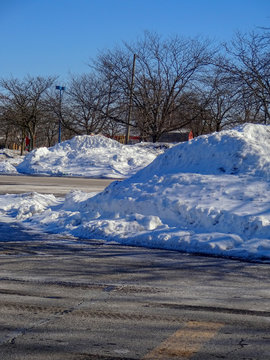Drifts left from snow removal for parking purposes.