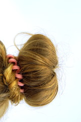 Long medium blond hair arranged in a classic knot.
