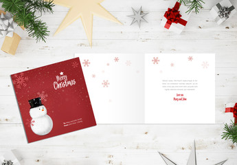 Christmas Card Layout with Snowman Illustration