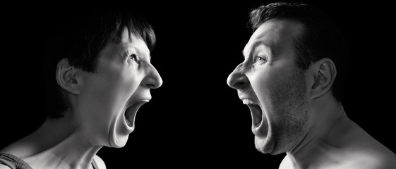Man and woman yell at each other on black isolated background.