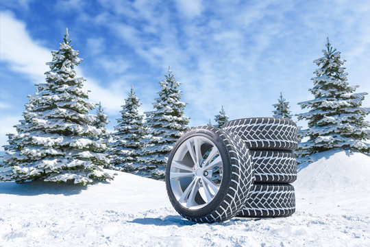 Snow tires on winter landscape background