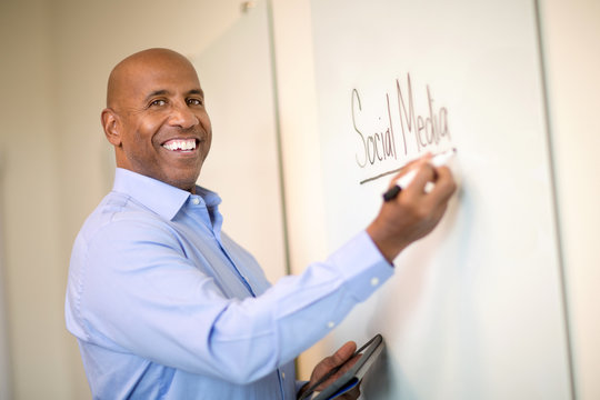 African American man at work in a training session.