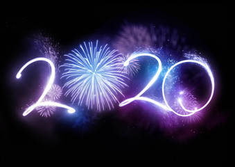 The year 2020 displayed with fireworks and strobes. New year celebration concept.
