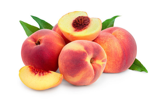 Ripe peach fruit and half with leaf isolated on white background
