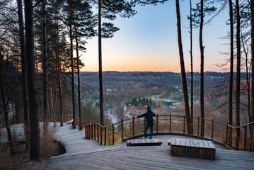 Fotorollo Grau Wooden viewpoint in Pavilniai Regional Park during sunrise.