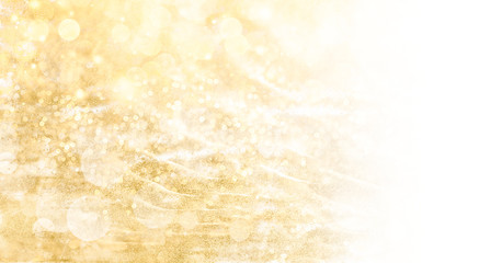 Golden Christmas background banner with festive shiny sparkles and twinkling bokeh