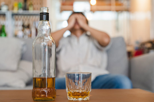 Alcoholism concept. Young man drinking alcohol too much.