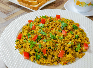 Spicy & colorful version of scrambled eggs. Indian Cuisine.