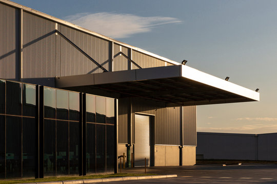 Industrial office & warehouse architecture bathed in afternoon light.