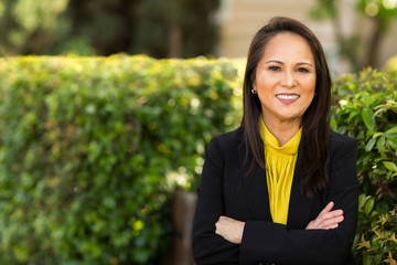 Portrait of a mature Asian woman in a business suit.