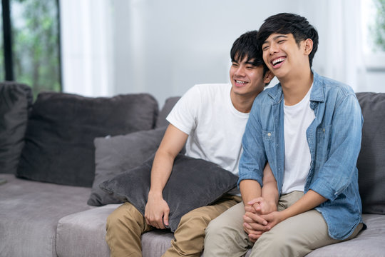 Young cute asian gay couple on Sofa.teens homosexual couple.LGBTG Concept.Love and Relationships