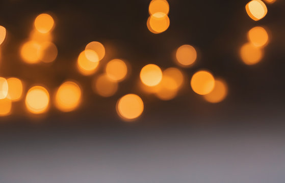 Abstract blurred shiny bokeh lights black background