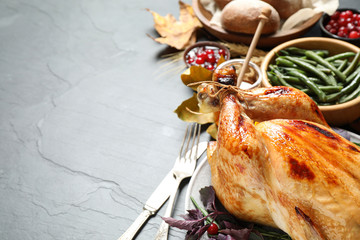 Composition with turkey on grey background, space for text. Happy Thanksgiving day