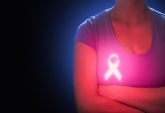 Woman and symbol of breast cancer awareness