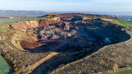 Aerial view of machinery in open gravel pit mining. Processing plant for crushed stone and gravel. Mining equipment