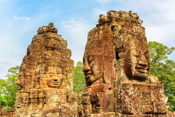 Wall Mural - Gorgeous view of towers with stone faces of Bayon temple