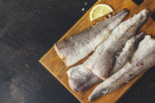 fish raw hake (set of ingredients for cooking). food background. top view. copy space