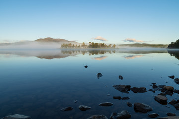Fotomurales - Tranquil dawn at a lake in Jamtland, Sweden.