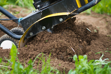 the cultivator tills the soil