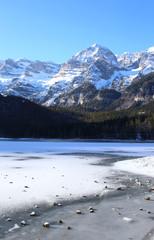 frozen alpine Lake Tovel of Dolomites, Italy