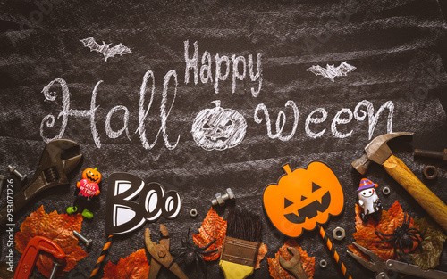Happy Halloween day with construction DIY handy tools on black chalk board background concept. Flat lay Top view.