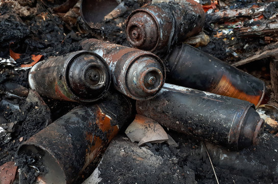 Burnt aerosol spray cans / Dealing with hazardous waste in a wrong way
