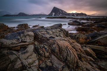 Moody arctic light on rocky shore in Norway