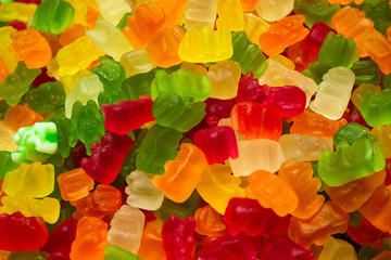 A bunch of colorful jelly candies in the form of bears. Colourful candy background