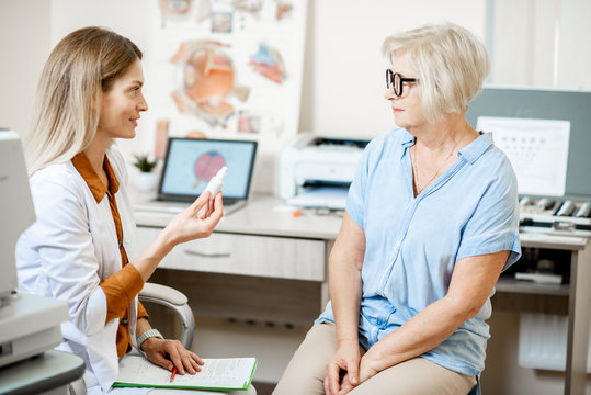 Senior woman patient talking with female ophthalmologist during a medical consultation at the ophthalmologic office