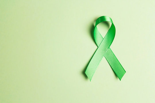 World mental health day concept. Green awareness ribbon with copy space for text .