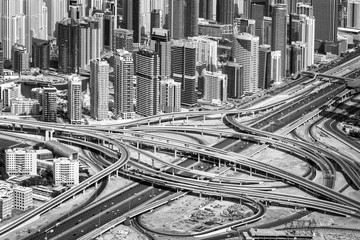 Aerial view of Sheikh Zayed road highway interchange and buildings in Dubai, United Arab Emirates