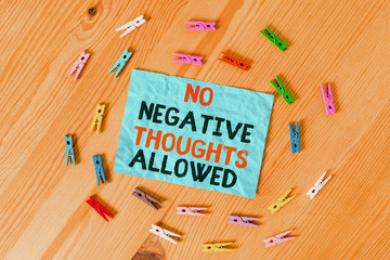 Word writing text No Negative Thoughts Allowed. Business photo showcasing Always positive motivated inspired good vibes Colored clothespin papers empty reminder wooden floor background office